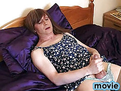 Slutty tranny Lucimay relaxing on her bed and masturbating