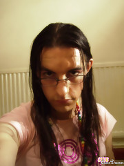 This crossdresser loves to put on her cute pink outfits for the camera.