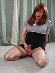 Sexy TGirl Lucimay wearing knee high leather boots and gorgeous stockings