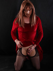 Lucimay is dressed in a lucious red dressed and as about to be gagged.