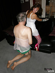 Nylon Jane in stockings and long satin gloves dominates crossdresser