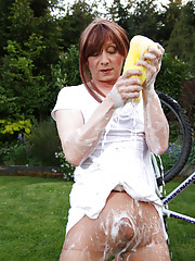 Sweet Lucimay gets very soapy as she cleans her bike