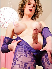 Purple lace bodystocking on sexy shemale Delia.